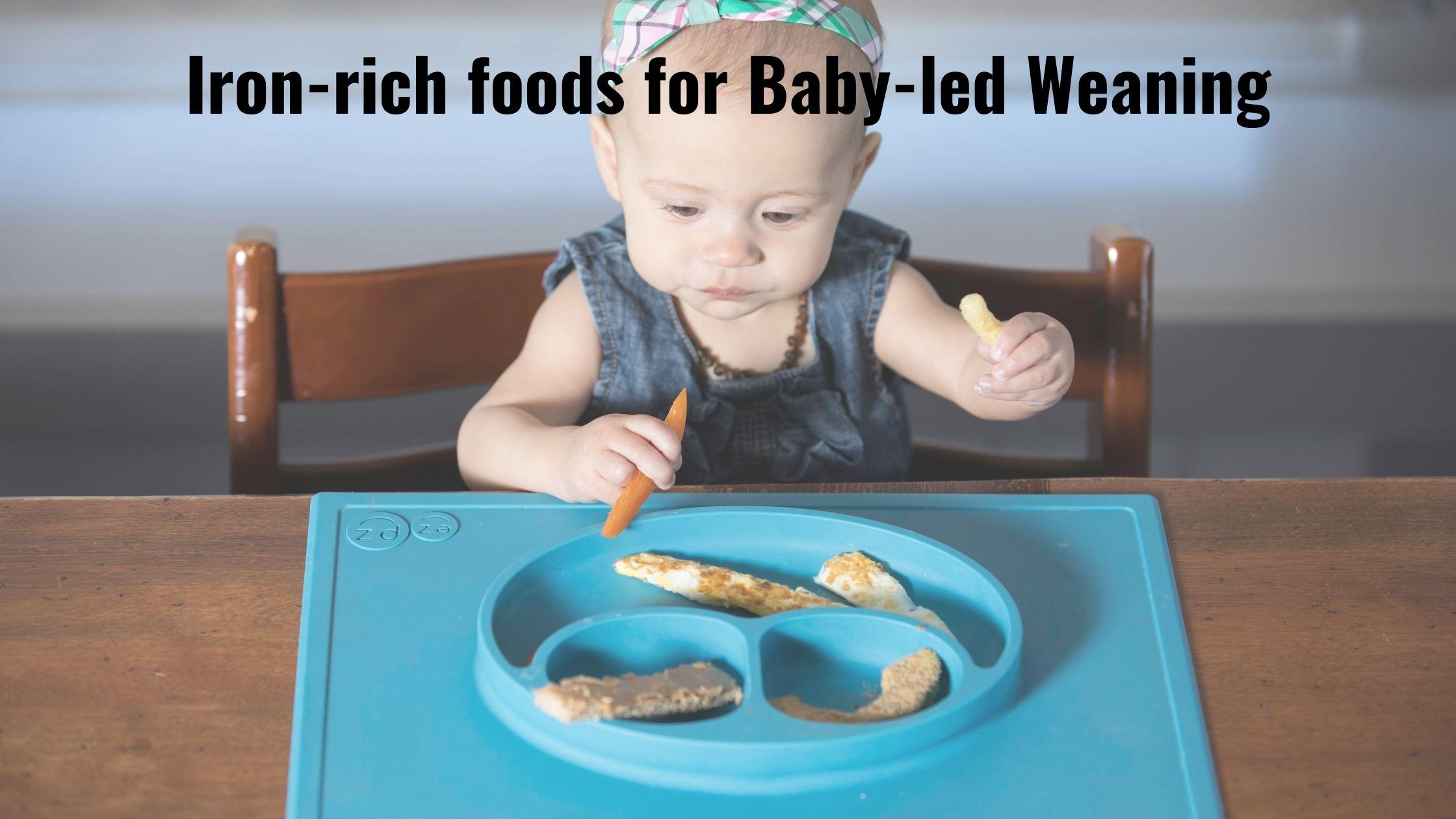 baby feeding herself iron-rich foods